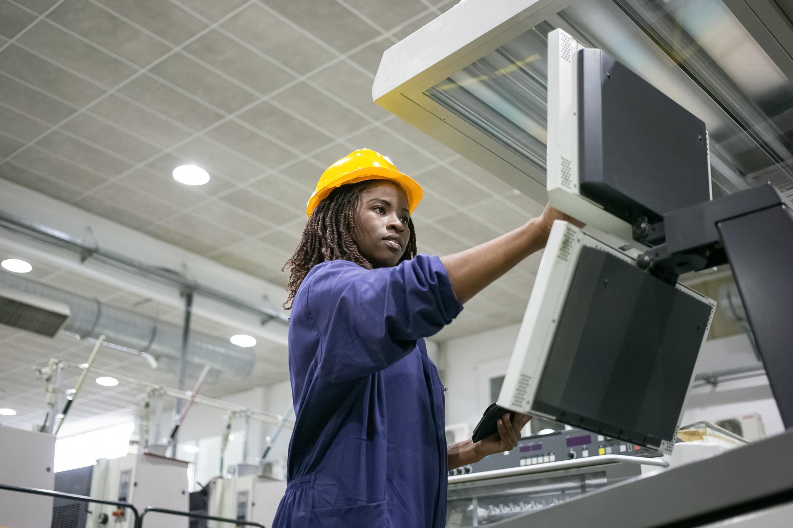 Focused confident black female factory worker